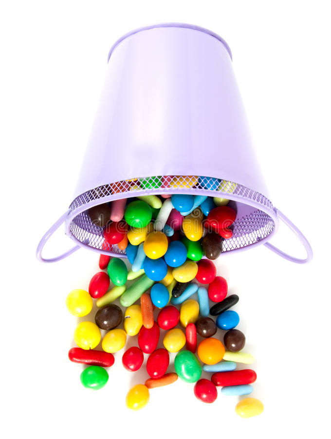A purple pot with sweet candy royalty free stock photography
