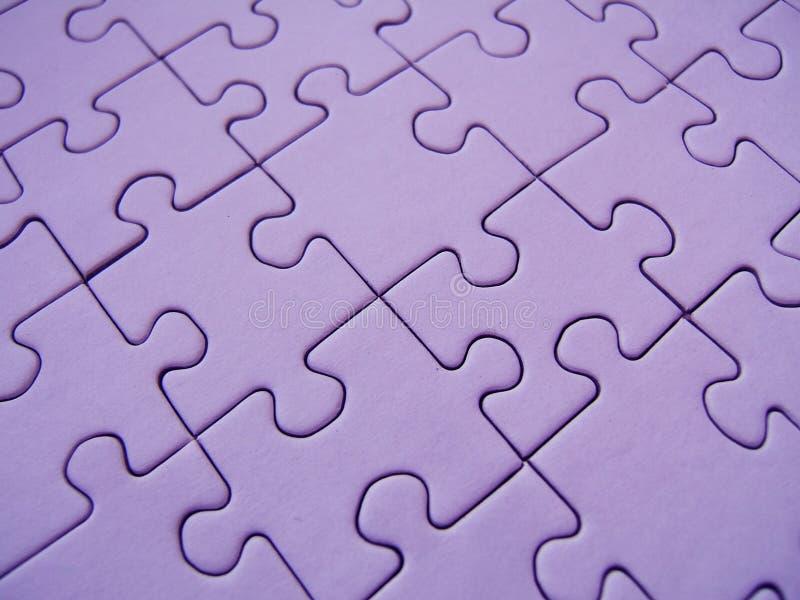 Purple puzzle royalty free stock photos