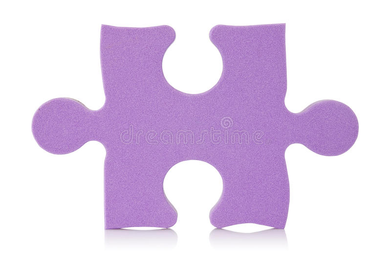 Purple puzzle piece royalty free stock image