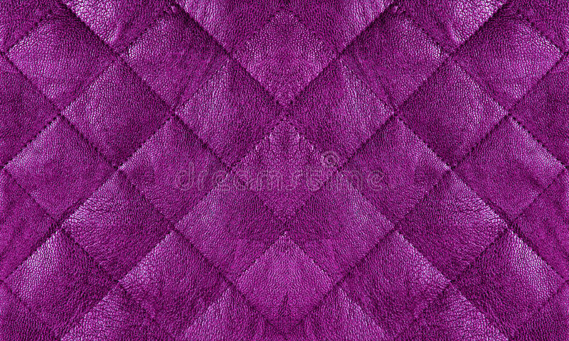 Purple quilted leather fabric close up, background royalty free stock photo