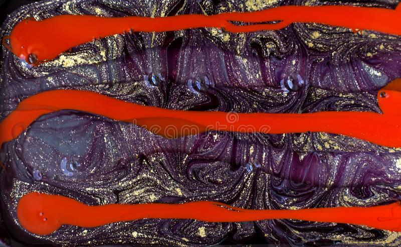 Purple and red marbling pattern. Golden marble liquid texture. royalty free stock image