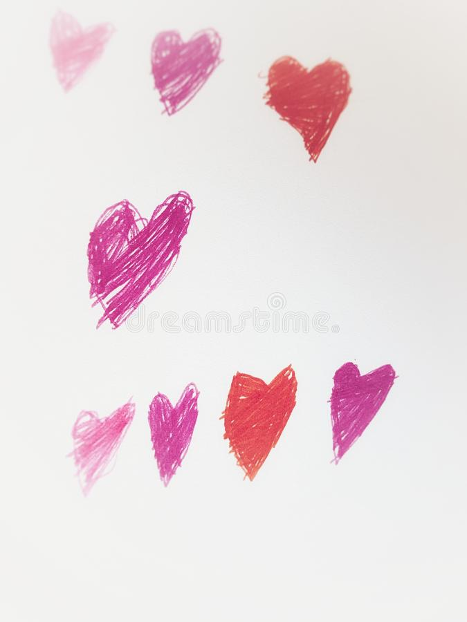 Purple red and pink hearts stock photo