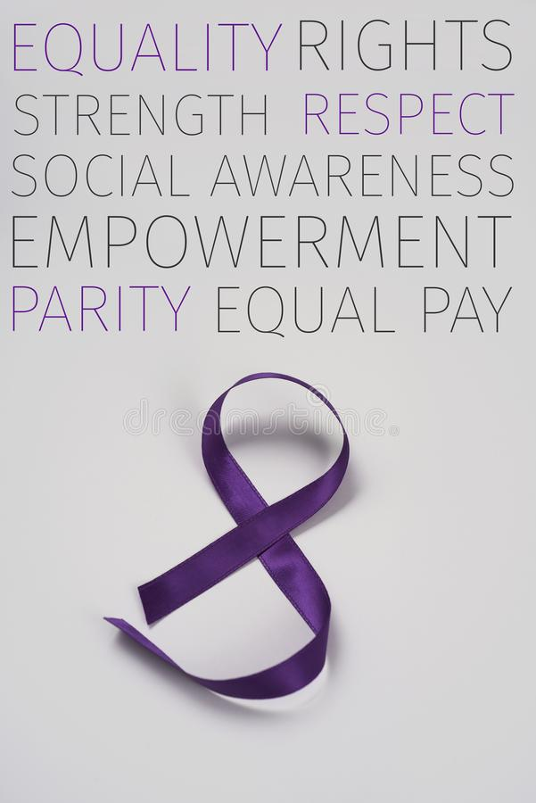 Purple ribbon as an 8, for march 8, the womens day. A purple ribbon forming an 8, for march 8, the womens day, and some concepts about the feminist movement royalty free stock image