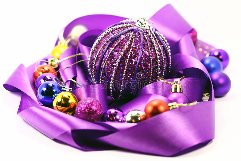 Purple ribbon and colorful balloons stock photos