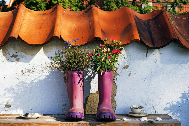Purple rubber boots with flowers stock photography