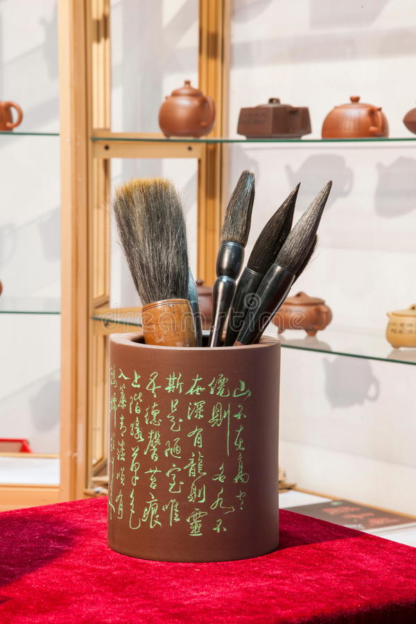 Purple sand brush pen holder. Brush (Chinese brush, writing brush), is a traditional writing instruments from China, have gradually become a traditional painting royalty free stock photos