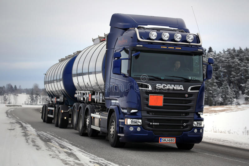 Purple Scania R580 Tank Truck in Winter. SALO, FINLAND - JANUARY 22, 2016: Purple Scania R580 Euro 6 tank truck moves along road in South of Finland. Scania stock images