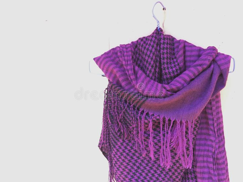 Purple scarf on white background. The purple scarf style for winter season stock image