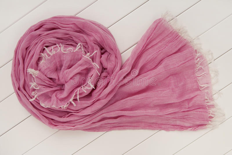 Purple scarf is on white show-case royalty free stock photos