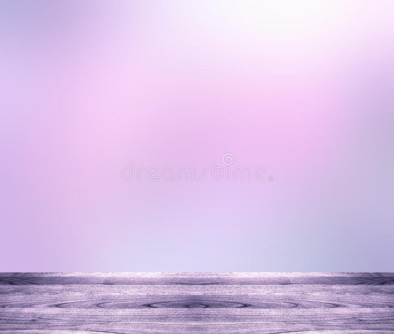 Purple shiny empty wooden table. Light shining blurred background. Spring abstract festive background. royalty free stock photo