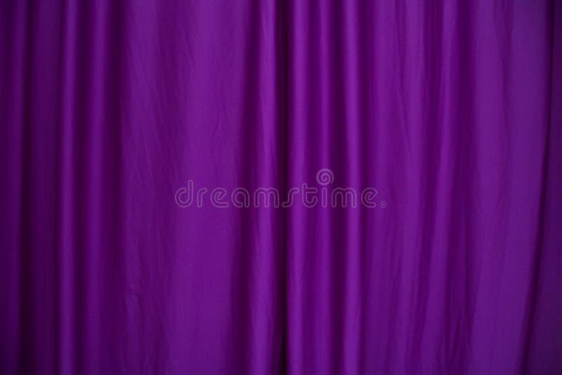 Purple curtain. Purple silk curtain as a background stock photography