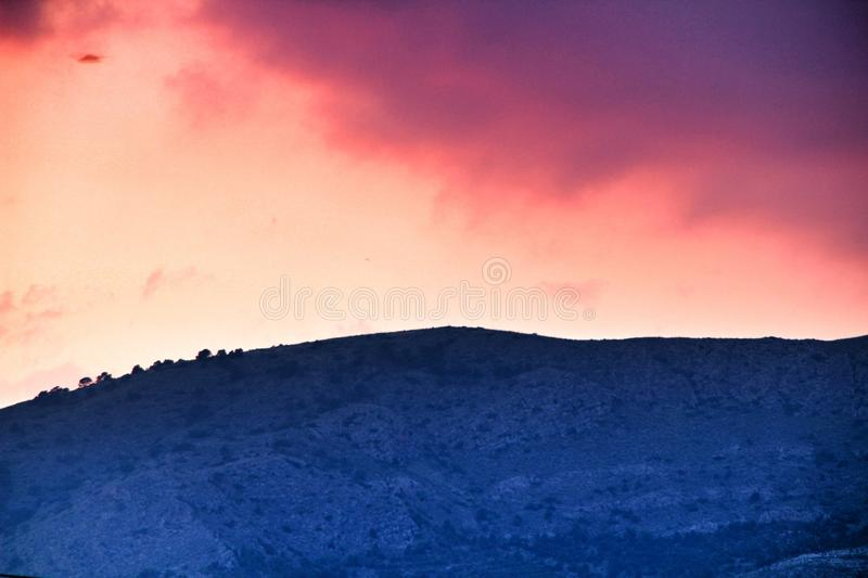 Purple sky at sunset in Spain. Beautiful purple and pink sky at sunset in Spain sunny colorful landscape orange reflection blue wallpaper dusk evening outdoor royalty free stock images