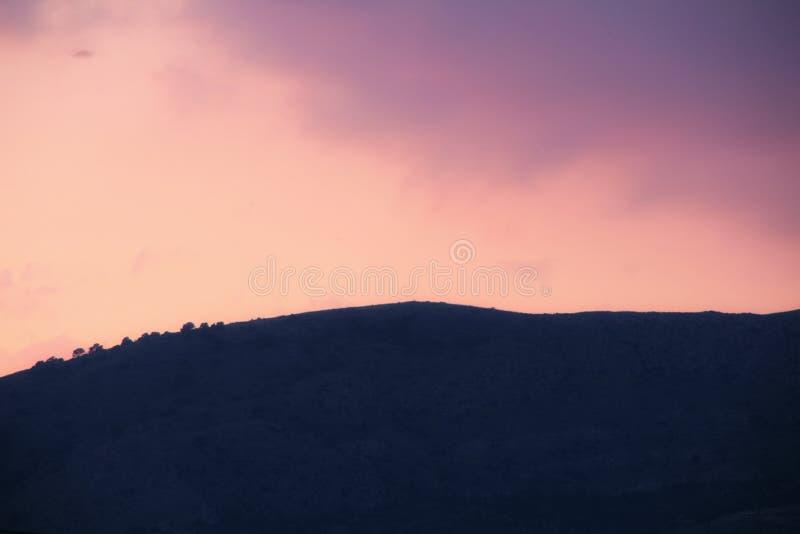 Purple sky at sunset in Spain. Beautiful purple and pink sky at sunset in Spain sunny colorful landscape orange reflection blue wallpaper dusk evening outdoor stock image