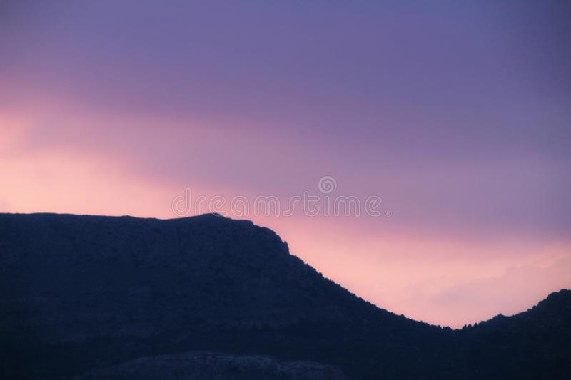 Purple sky at sunset in Spain. Beautiful purple and pink sky at sunset in Spain sunny colorful landscape orange reflection blue wallpaper dusk evening outdoor royalty free stock image