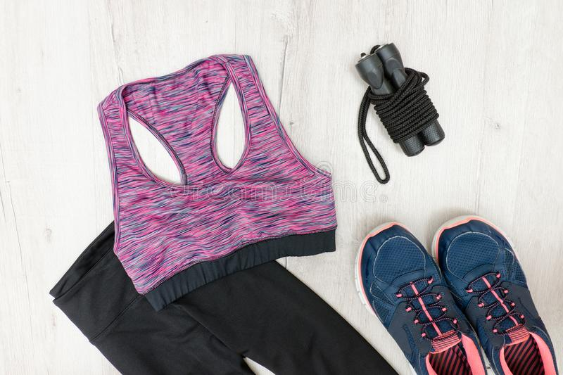 Purple sports top, breeches and sneakers. Fashionable sports con. Cept royalty free stock photos