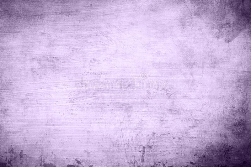 Purple strokes abstract background or texture. Detail of old distressed lilac wall background or texture with dark vignette borders stock photo