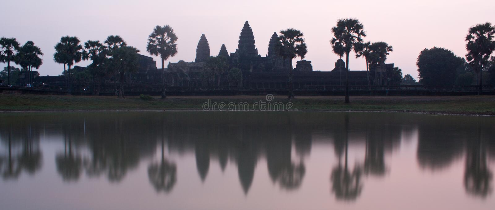 A purple sunrise photo of UNESCO Angkor Wat Temple near Siem Reap in Cambodia. In Asia, ancient, archaeology, architecture, art, asian, beautiful, blue stock image