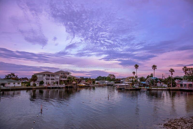 Purple sunset at Hudson beach, florida stock photo
