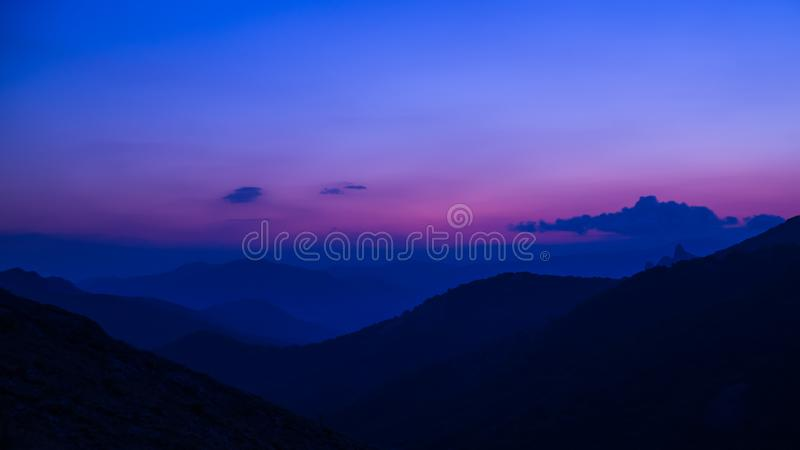 Purple sunset in the mountains stock image