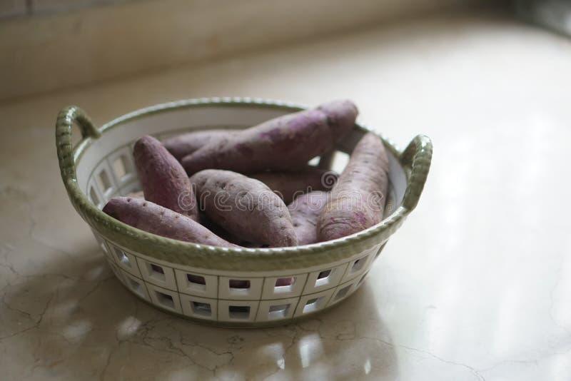 Purple sweet potato in a basket royalty free stock photo