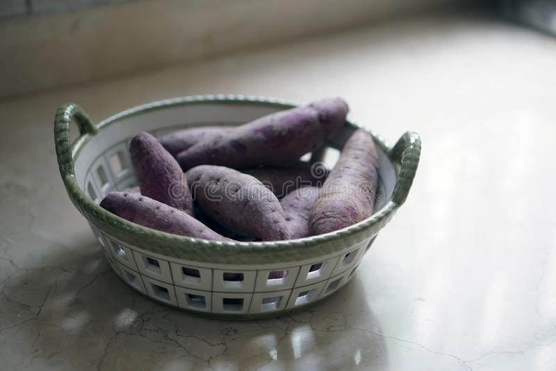 Purple sweet potato in a basket stock photos