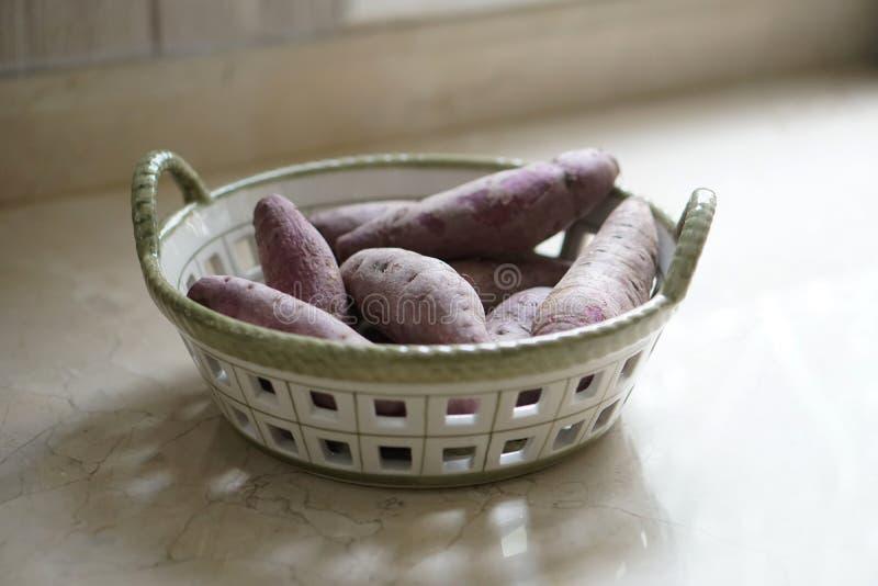 Purple sweet potato in a basket stock image