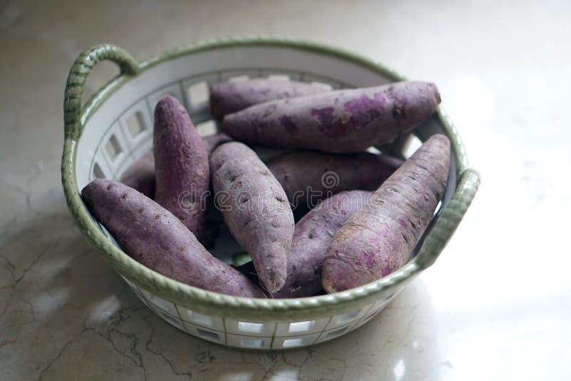 Purple sweet potato in a basket. Purple sweet potato in basket stock photo