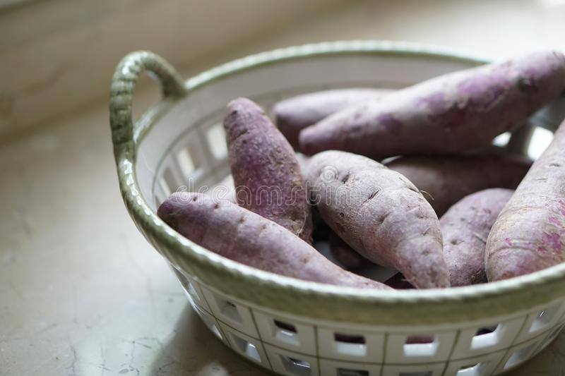 Purple sweet potato in a basket stock images