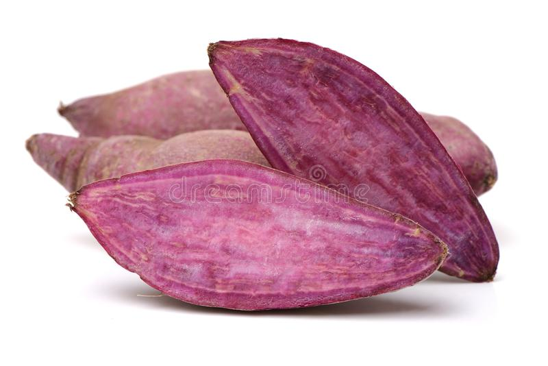 Purple sweet potato. Isolated on the white background royalty free stock photography
