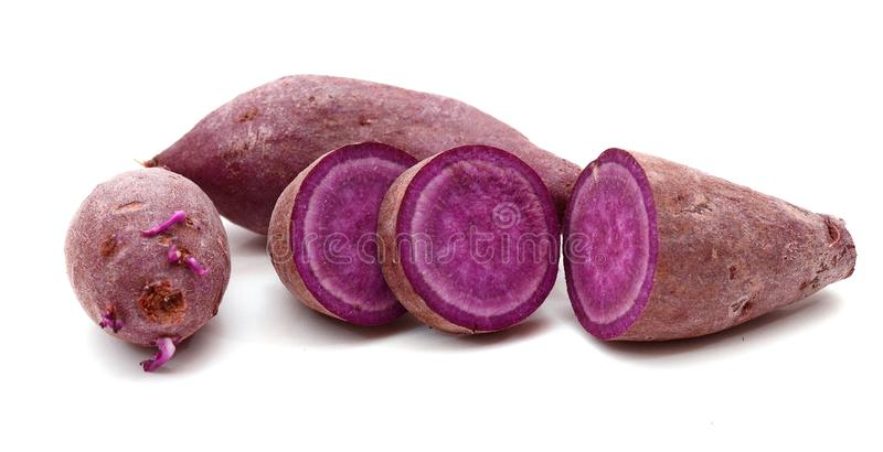 Purple sweet potato. Section, background. Purple sweet potato. Prepared, heap royalty free stock image