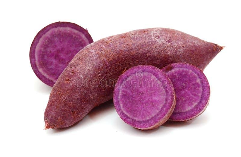 Purple sweet potato. Section, background. Purple sweet potato. Prepared, heap royalty free stock photography