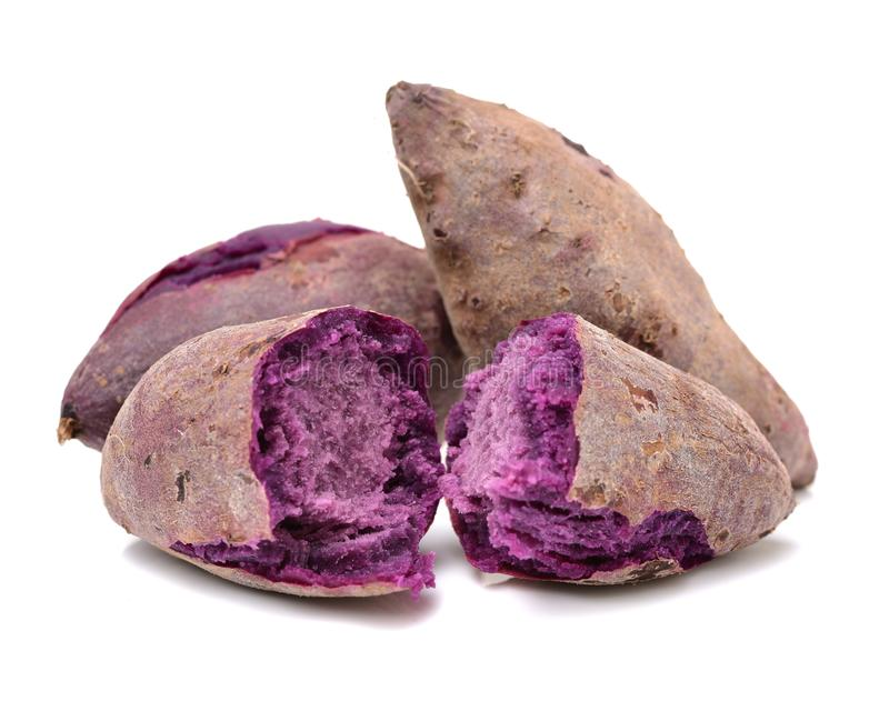 Purple sweet potato. Isolated on the white background stock images