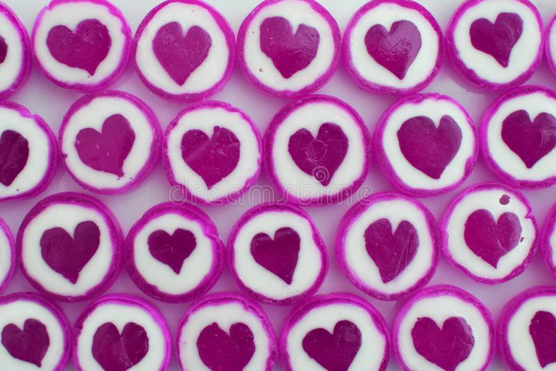 Purple sweet sugar candies as background royalty free stock photo