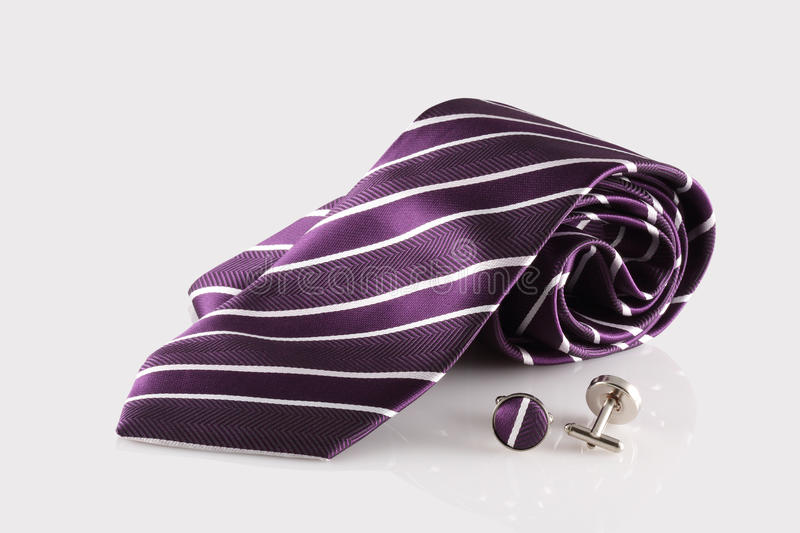 Purple tie with cuff links stock photo