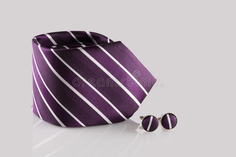 Purple tie with cuff links royalty free stock image