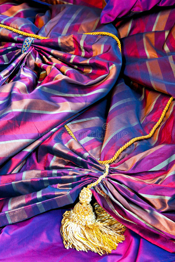 Purple upholstery. Close up shot of purple upholstery material stock photo