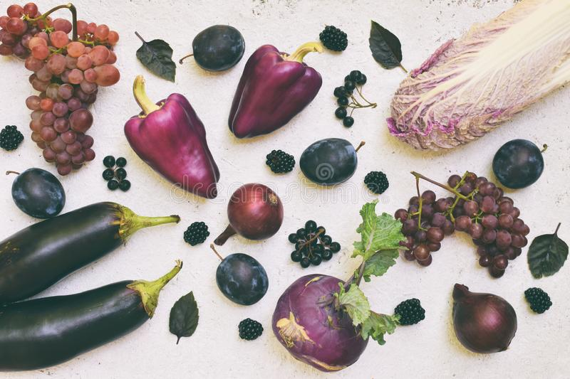Purple vegetables and fruits. Plum, eggplant, pepper, blueberries, rowanberry. Violet organic foods high in antioxidants, anthocya stock photography