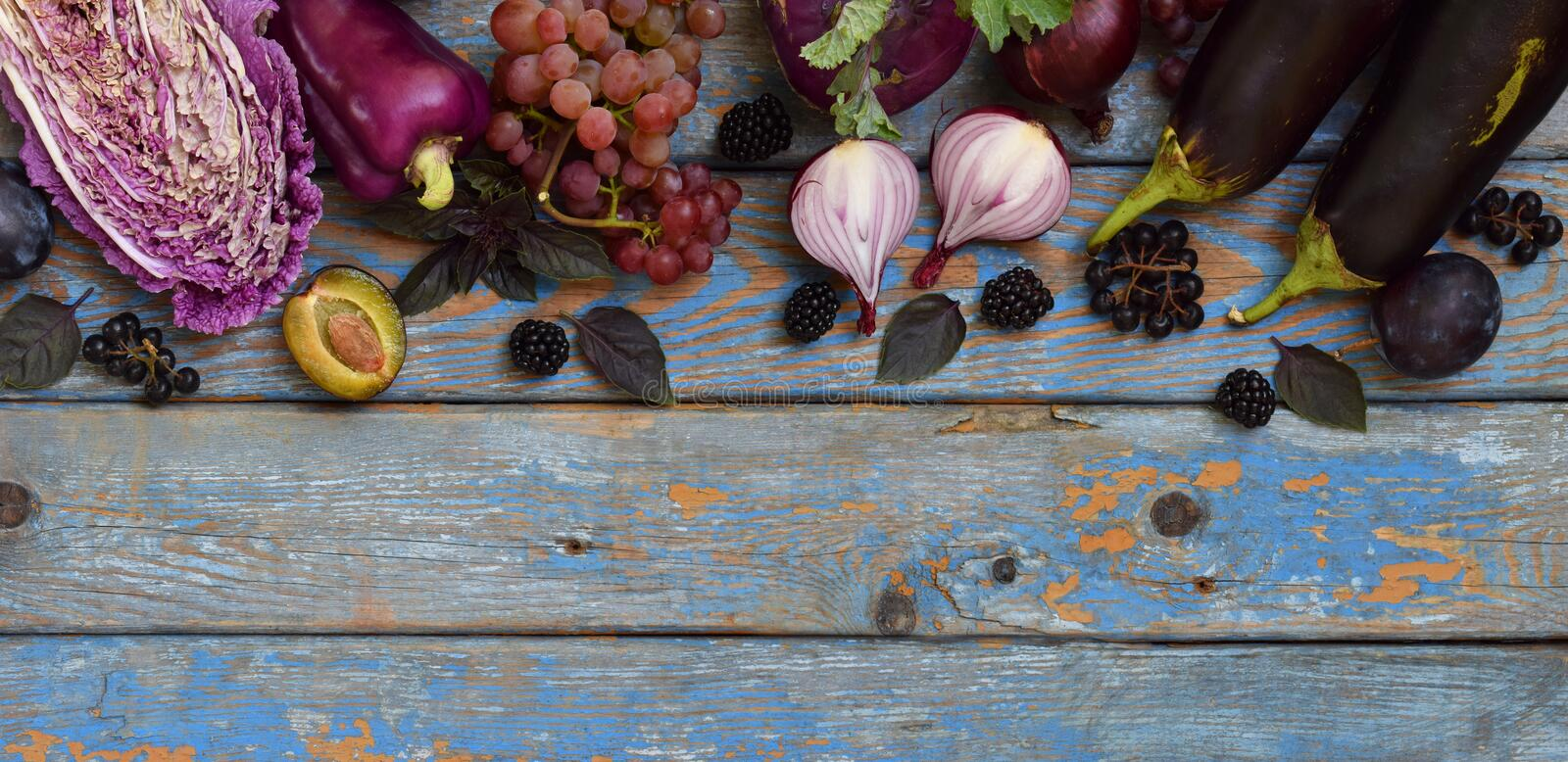 Purple vegetables and fruits. Plum, eggplant, pepper, blueberries, rowanberry. Violet organic foods high in antioxidants, anthocya. Nins and vitamins. Raw food stock photography