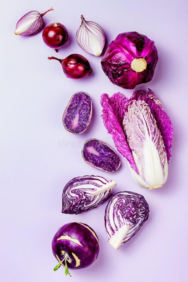 Purple vegetables on pastel color background. Minimal concept. Plant based vegan or vegetarian cooking. Clean eating food. Alkaline diet royalty free stock image