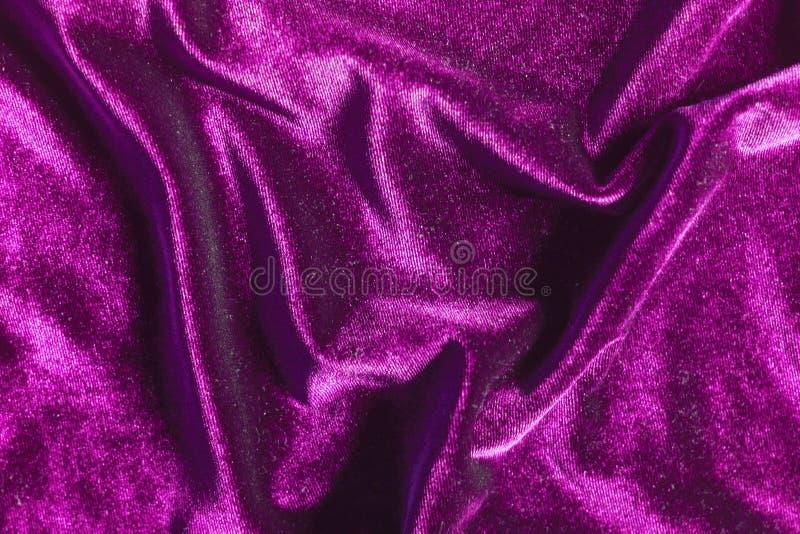 Purple velvet folds texture background stock image