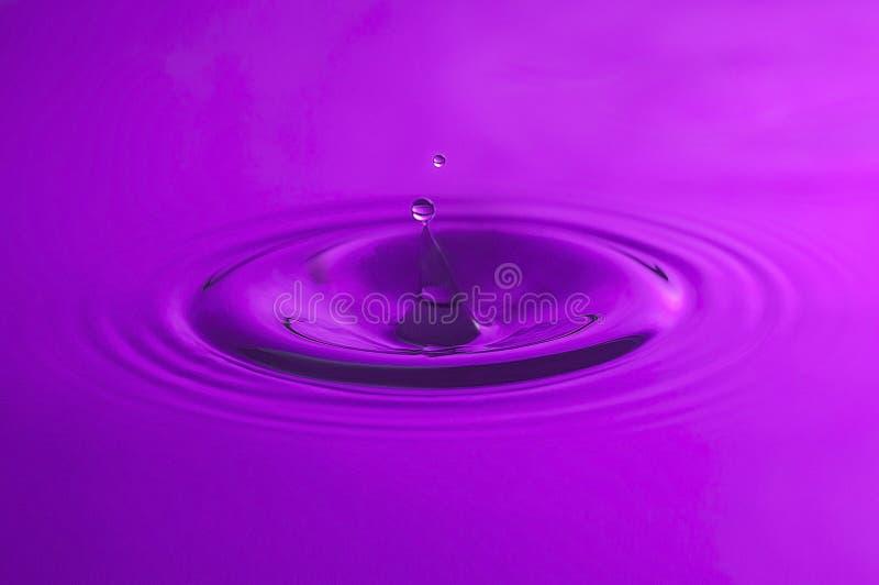 Purple Water drop close up. royalty free stock photos