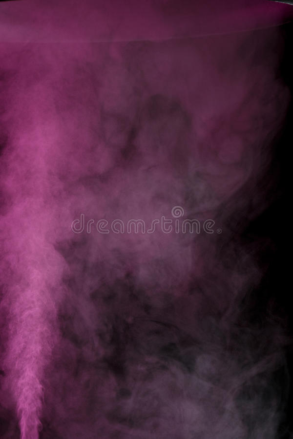 Purple water vapor. Abstract purple water vapor on a black background. Texture. Design elements. Abstract art. Steam the humidifier. Macro shot royalty free stock photo