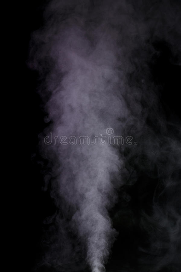 Purple water vapor. Abstract purple water vapor on a black background. Texture. Design elements. Abstract art. Steam the humidifier. Macro shot stock images