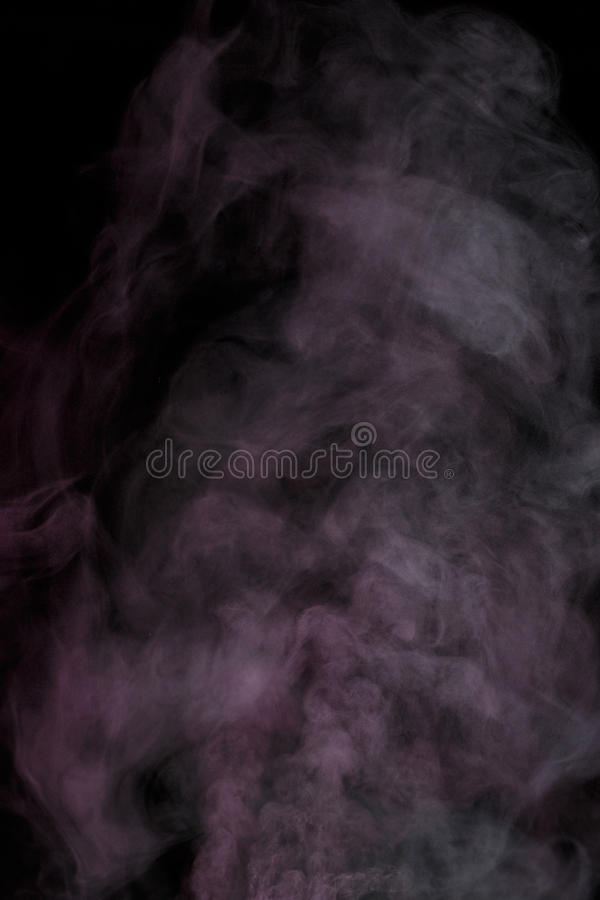 Purple water vapor. Abstract purple water vapor on a black background. Texture. Design elements. Abstract art. Steam the humidifier. Macro shot stock photo