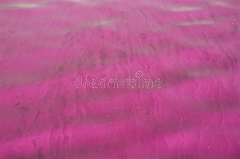 Purple waves. Soft purple traversed by waves of colored water flow streaks royalty free stock photography