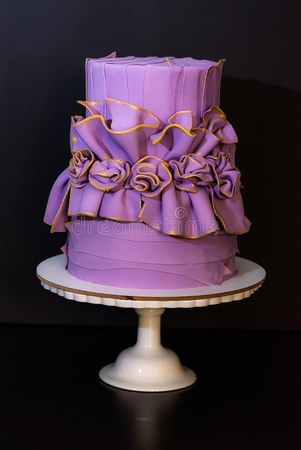 Purple wedding cake with flowers royalty free stock photo