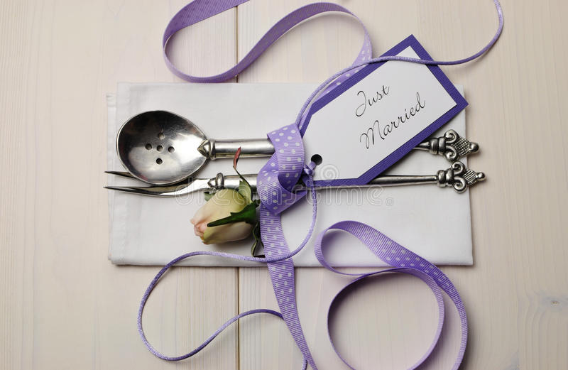 Purple and white shabby chic wedding table setting