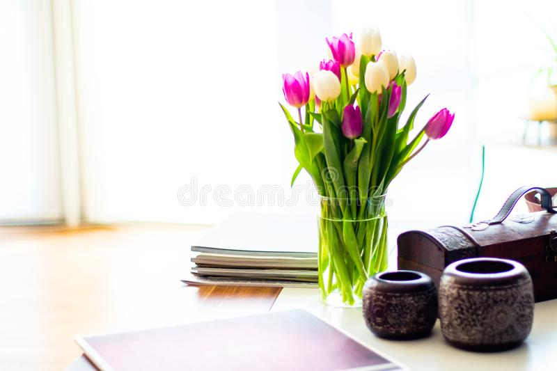 Purple and white tulips on the living room table royalty free stock photography