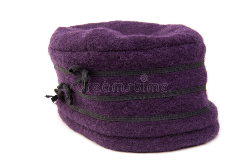 Purple winter hat. A purple wool winter hat, isolated on white stock photo