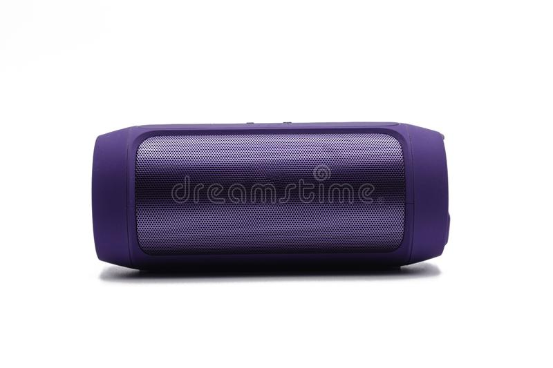 Purple Wireless or Bluetooth portable speaker for connecting to other device in white background or isolated. Purple Wireless or Bluetooth portable speaker for stock photos